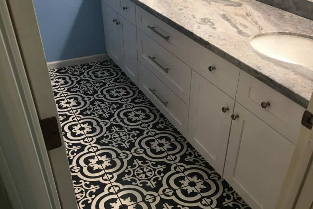 Bathroom Floor Remodel with black and white tile