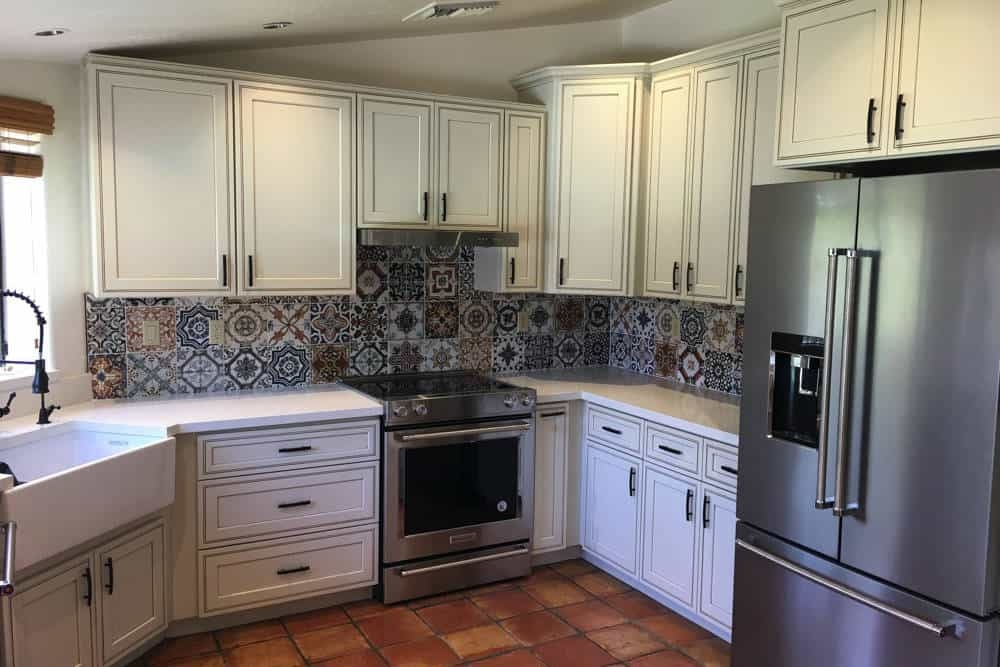 A kitchen we remodeled with modern cabinets and a beautiful stone backsplash